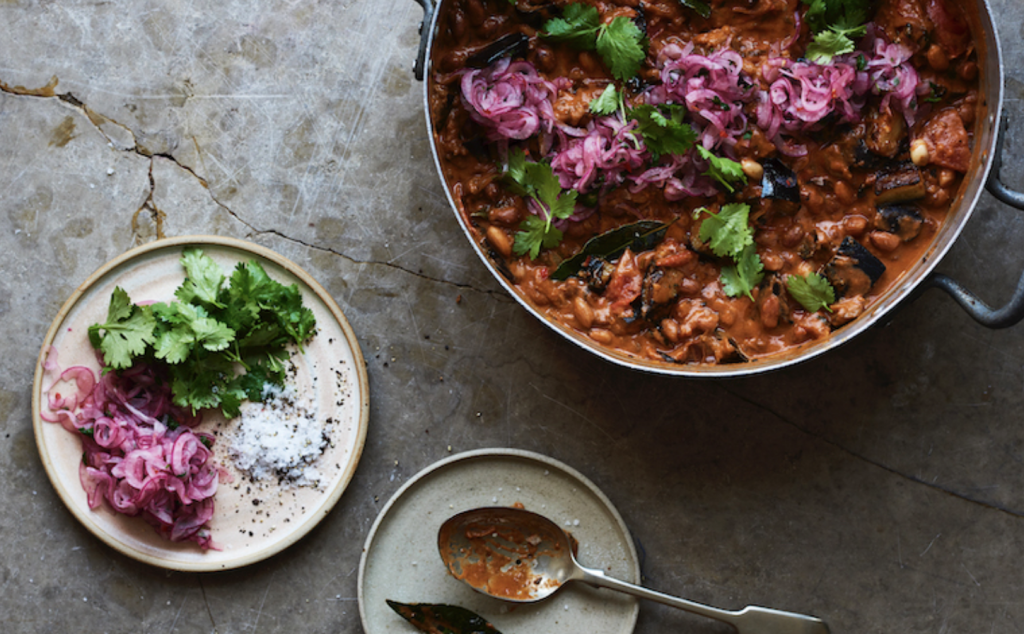 Aubergine and peanut stew with pink onions